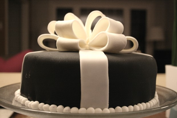 Black cake with white fondant bow